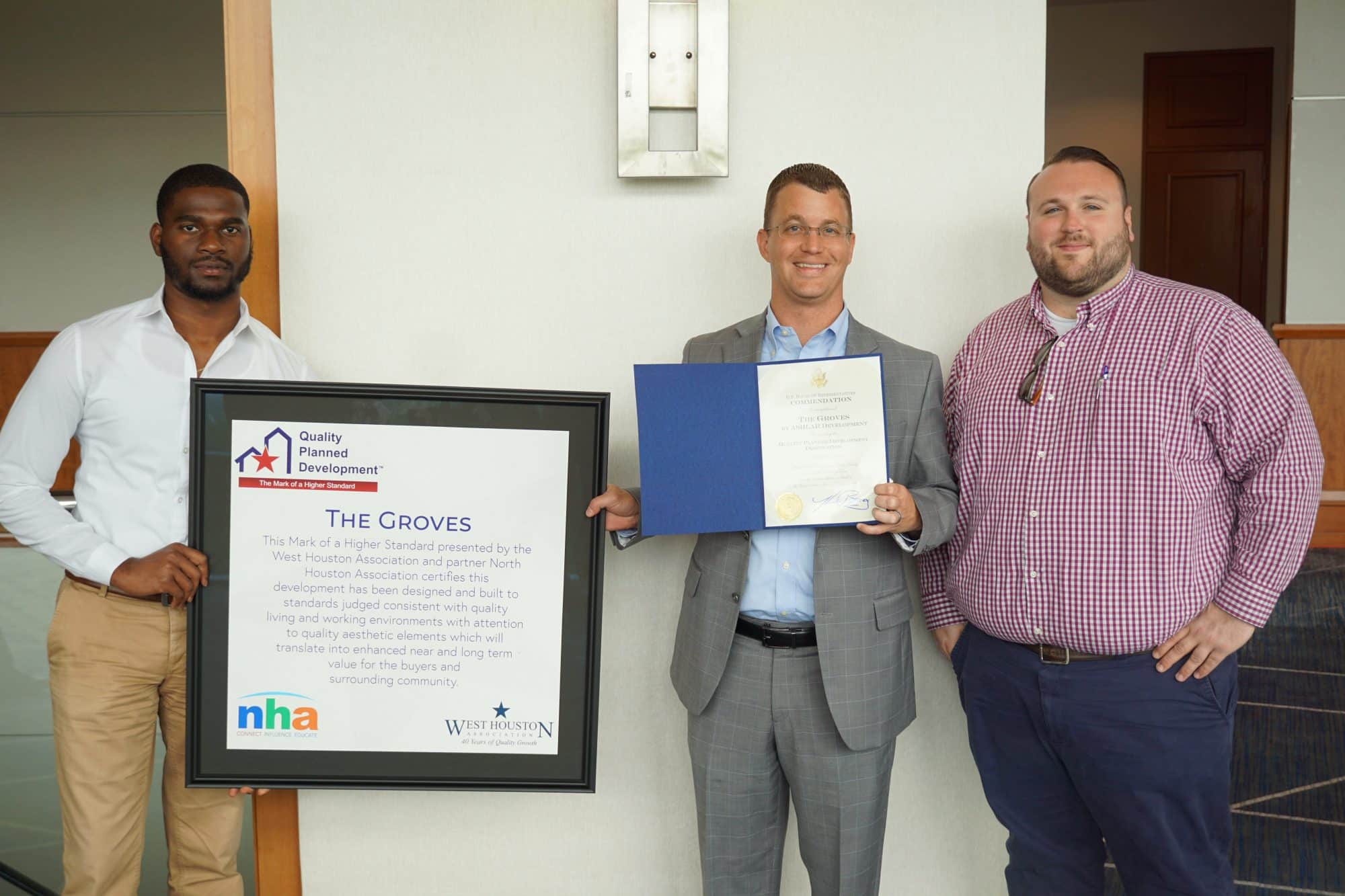 Ashlar team members Royce Brooks, Mike Miller and Brad McFarland with award